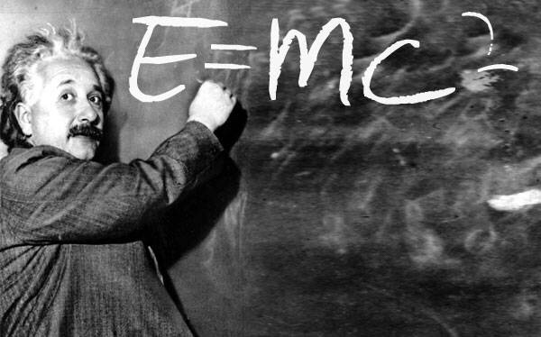 Albert Einstein at the blackboard with his equation E=MC2