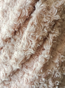 Soft, pink blanket with a rose motif