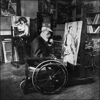 Renoir painting in his studio