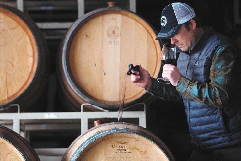 A wine maker tasting wine