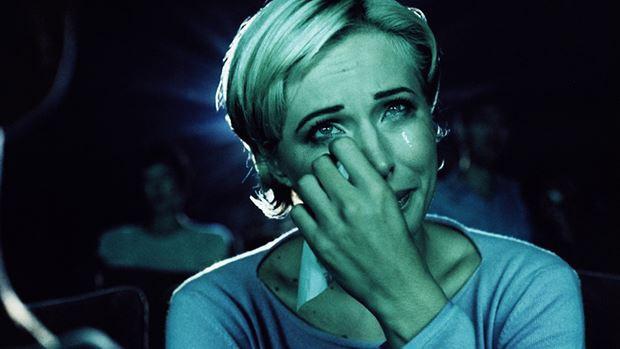Woman watching a sad film
